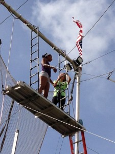 Emily Rose with her talented Trapeze Austin instructors