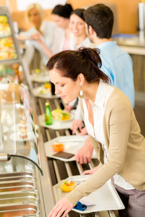 Business woman choose cafeteria lunch buffet
